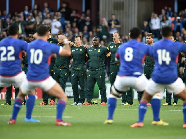 South Africa's prop Trevor Nyakane (C) stands with South Africa team mates as they watch the Samoa team perform the Haka ahead of the Pool B match of the 2015 Rugby World Cup between South Africa and Samoa at Villa Park in Birmingham, central England, on