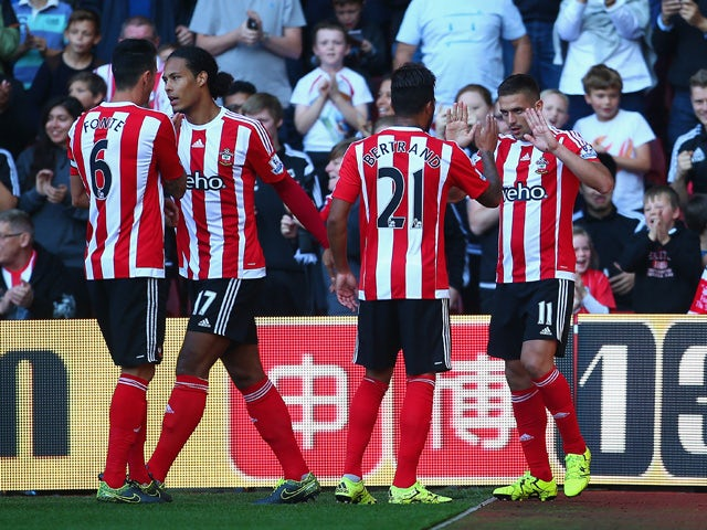 Dusan Tadic (R) of Southampton celebrates scoring his team's second goal with his team mates during the Barclays Premier League match between Southampton and Swansea City at St Mary's Stadium on September 26, 2015