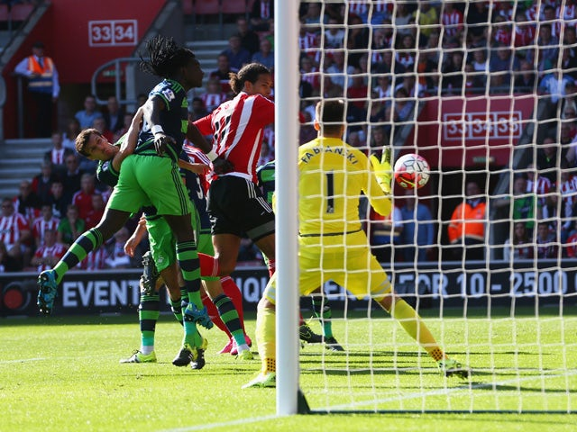 Virgil van Dijk of Southampton scores his team's first goal during the Barclays Premier League match between Southampton and Swansea City at St Mary's Stadium on September 26, 2015