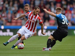 Marko Arnautovic of Stoke City and Matt Ritchie of Bournemouth compete for the ball during the Barclays Premier League match between Stoke City and A.F.C. Bournemouth at Britannia Stadium on September 26, 2015