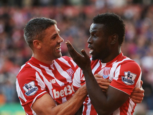 Mame Biram Diouf (L) of Stoke City celebrates scoring his team's second goal with his team mate Jonathan Walters (R) during the Barclays Premier League match between Stoke City and A.F.C. Bournemouth at Britannia Stadium on September 26, 2015