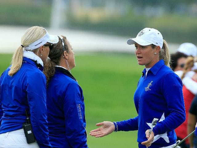 Suzann Pettersen of the European team trying to explain to her captain Carin Koch (l) the length of putt that she did not concede to Alison Lee on the 17th green in her match with Charley Hull (r) against Alison Lee and Brittany Lincicome of the United St