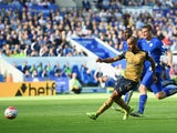 Theo Walcott of Arsenal scores his team's first goal during the Barclays Premier League match between Leicester City and Arsenal at The King Power Stadium on September 26, 2015 in Leicester, United Kingdom.
