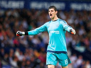 Thibaut Courtois of Chelsea celebrates the opening goal scored by Pedro of Chelsea during the Barclays Premier League match between West Bromwich Albion and Chelsea at The Hawthorns on August 23, 2015