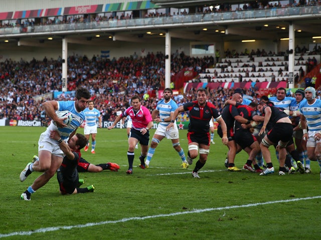 Tomas Cubelli of Argentina scores his teams second try during the 2015 Rugby World Cup Pool C match between Argentina and Georgia at Kingsholm Stadium on September 25, 2015