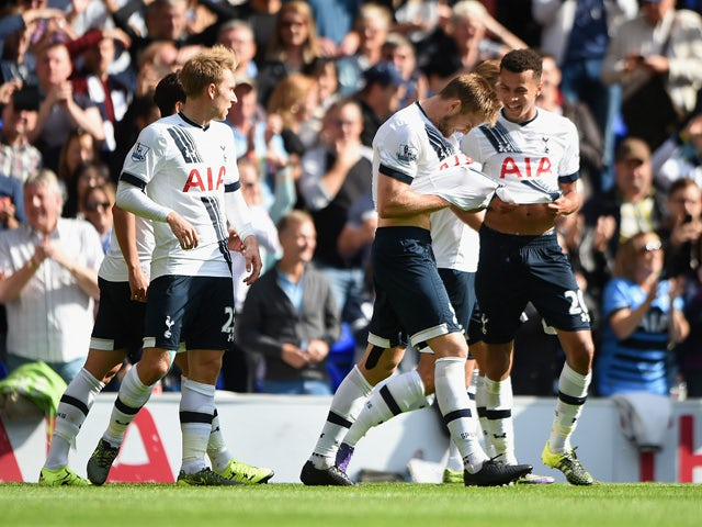 Eric Dier (2nd R) of Tottenham Hotspur celebrates scoring his team's first goal with his team mates during the Barclays Premier League match between Tottenham Hotspur and Manchester City at White Hart Lane on September 26, 2015