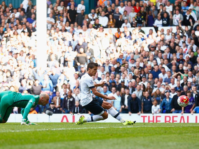 Erik Lamela of Tottenham Hotspur scores his team's fourth goal during the Barclays Premier League match between Tottenham Hotspur and Manchester City at White Hart Lane on September 26, 2015