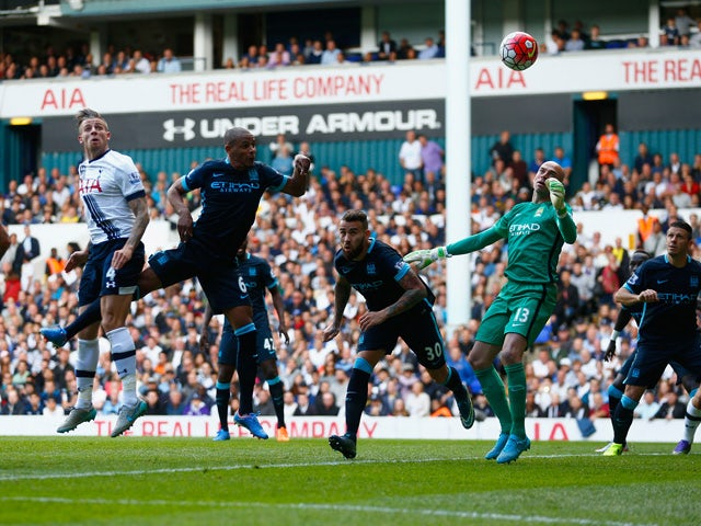 Toby Alderweireld (2nd L) of Tottenham Hotspur scores his team's second goal during the Barclays Premier League match between Tottenham Hotspur and Manchester City at White Hart Lane on September 26, 2015