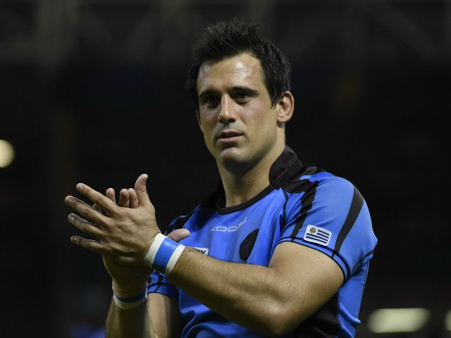 Uruguary's lock Santiago Vilaseca applauds the fans after losing a Pool A match of the 2015 Rugby World Cup between Wales and Uruguay at the Millennium stadium in Cardiff, south Wales on September 20, 2015.