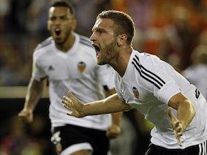 Valencia edge out Granada