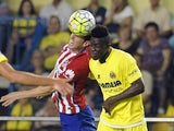 Atletico Madrid's Uruguayan defender Diego Godin (L) vies with Villarreal's Ivorian defender Eric Bally during the Spanish league football match Villarreal CF vs Club Atletico de Madrid at El Madrigal stadium in Villareal on September 26, 2015.
