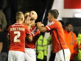 Walsall's English defender James O'Connor (C) celebrates with teammates after scoring their first goal during the English League Cup third round football match between Walsall and Chelsea at The Banks's Stadium in Walsall, central England on September 23,