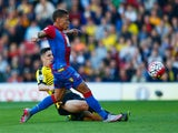 Dwight Gayle of Crystal Palace hits the post with a shot as Craig Cathcart of Watford challenges during the Barclays Premier League match between Watford and Crystal Palace at Vicarage Road on September 27, 2015