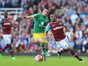 Dimitri Payet of West Ham United and Graham Dorrans of Norwich City compete for the ball during the Barclays Premier League match between West Ham United and Norwich City at the Boleyn Ground on September 26, 2015