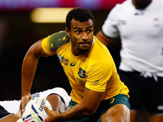 Will Genia of Australia dispatches the ball during the 2015 Rugby World Cup Pool A match between Australia and Fiji at the Millennium Stadium on September 23, 2015