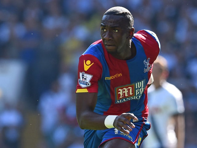 Crystal Palace's French-born Congolese midfielder Yannick Bolasie runs with the ball during the English Premier League football match between Tottenham Hotspur and Crystal Palace at White Hart Lane in north London on September 20, 2015