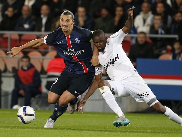 Paris Saint-Germain's Swedish forward Zlatan Ibrahimovic (L) vies with Guingamp's Senegalese midfielder Moustapha Diallo during the French L1 football match between Paris Saint-Germain (PSG) and EA Guingamp on September 22, 2015 at the Parc des Princes st
