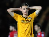 Aaron Collins of Newport County shows dejection at the end of the Sky Bet League Two match between Newport County and Crawley Town at Rodney Parade on September 29, 2015