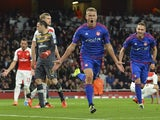 Olympiakos's Icelandic striker Alfred Finnbogason (C) celebrates scoring their third goal during the UEFA Champions League Group F football match between Arsenal and Olympiakos at The Emirates Stadium in north London on September 29, 2015.