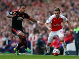 Memphis Depay of Manchester United and Aaron Ramsey of Arsenal during the Barclays Premier League match between Arsenal and Manchester United at Emirates Stadium on October 4, 2015 in London, England.