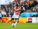 Ayumu Goromaru of Japan kicks at goal during the 2015 Rugby World Cup Pool B match between Samoa and Japan at Stadium mk on October 3, 2015