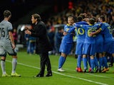 Roma's French coach Rudi Garcia (C) gives instructions to his player as BATE's players celebrate a goal during the UEFA Champions League group E football match between FC BATE Borisov and AS Roma at the Borisov-Arena in Borisov outside Minsk on September