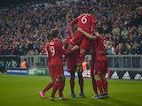Bayern Munich's players celebrate after the fourth goal during the Group F, first-leg UEFA Champions League football match FC Bayern Munich vs GNK Dinamo Zagreb in Munich, on September 29, 2015.