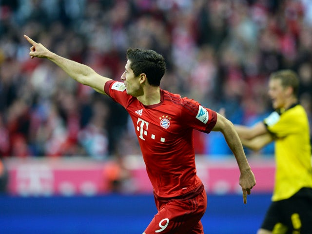 Bayern Munich's Polish striker Robert Lewandowski celebrates after he scores the second goal for Munich during the German first division Bundesliga football match FC Bayern Munich vs Borussia Dortmund in Munich, southern Germany, on October 4, 2015