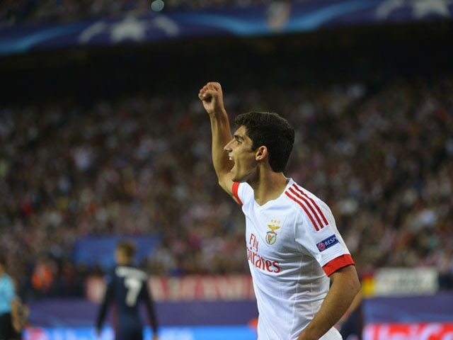 Benfica's forward Goncalo Guedes celebrates after scoring during the UEFA Champions League football match Club Atletico de Madrid vs SL Benfica at the Vicente Calderon stadium in Madrid on September 30, 2015