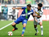 Monchengladbach's midfielder Mahmoud Dahoud (R) and Wolfsburg's striker Max Kruse vie for the ball during the German first division Bundesliga football match Borussia Monchengladbach vs VfL Wolfsburg in Moenchengladbach, western Germany, on October 3, 201
