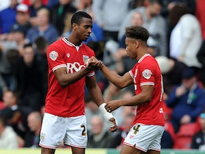 Jonathan Kodjia of Bristol City celebrates his sides first goal with Bobby Reid of Bristol City during the Sky Bet Championship match between Bristol City and MK Dons at Ashton Gate on October 3, 2015