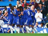Willian (C) of Chelsea celebrates with team mates after scoring the first goal during the Barclays Premier League match between Chelsea and Southampton at Stamford Bridge on October 3, 2015 in London, United Kingdom.