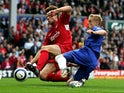 Xabi Alonso of Liverpool tackles but can't stop Damien Duff of Chelsea scoring a goal during the Barclays Premiership match between Liverpool and Chelsea at Anfield on October 2, 2005