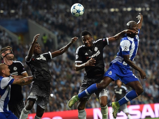 Chelsea's Nigerian midfielder John Obi Mikel (2nd R) vies with Porto's midfielder Danilo Pereira (R) during the UEFA Champions League Group G football match at the Dragao stadium in Porto on September 29, 2015.