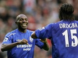 Geremi (L) of Chelsea is congratulated by Didier Drogba after scoring the fourth goal of the game during the Barclays Premiership match between Liverpool and Chelsea at Anfield on October 2, 2005