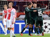 Real Madrid's Portuguese forward Cristiano Ronaldo (2nd R) is congratuled by teammates after scoring a goal during the UEFA Champions League Group D football match Ajax Amsterdam vs Real Madrid on October 3, 2012