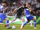 Chelsea's Brazilian-born Spanish striker Diego Costa (C) controls the ball next to Porto's midfielder Ruben Neves (L) and Brazilian defender Maicon during the UEFA Champions League Group G football match between FC Porto and Chelsea FC at the at the Draga
