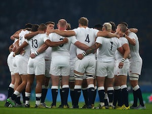 England players huddle prior to the Rugby World Cup match with Australia on October 3, 2015
