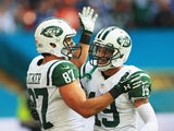 Eric Decker celebrates scoring his second touchdown for the New York Jets with Devin Smith in the game against the Miami Dolphins at Wembley on October 4, 2015