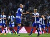 Porto's Brazilian defender Maicon (L) celebrates a goal with Porto's Uruguayan defender Maxi Pereira (R) during the UEFA Champions League Group G football match at the Dragao stadium in Porto on September 29, 2015.