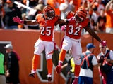 Giovani Bernard #25 of the Cincinnati Bengals is congratulated by Jeremy Hill #32 of the Cincinnati Bengals after scoring a touchdown during the first quarter of the game against the Kansas City Chiefs at Paul Brown Stadium on October 4, 2015
