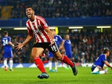 Graziano Pelle of Southampton celebrates scoring his team's third goal during the Barclays Premier League match between Chelsea and Southampton at Stamford Bridge on October 3, 2015 in London, United Kingdom.