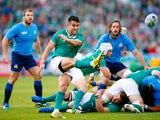 Conor Murray of Ireland kicks the ball during the 2015 Rugby World Cup Pool D match between Ireland and Italy at the Olympic Stadium on October 4, 2015 in London, United Kingdom.