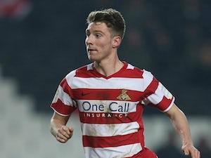 James Husband extends Huddersfield loan