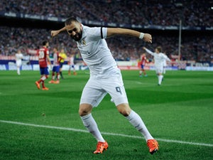 Karim Benzema of Real Madrid celebrates after scoring Real's opening goal during the La Liga match between Club Atletico de Madrid and Real Madrid at Vicente Calderon Stadium on October 4, 2015