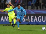 Gent's Israeli midfielder Kenny Saief (L) vies with Zenit's Brazilian forward Hulk during the UEFA Champions League group H football match between FC Zenit and KAA Gent at the Petrovsky stadium in St. Petersburg on September 29, 2015.