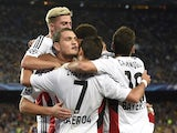 Bayer Leverkusen's Greek defender Kyriakos Papadopoulos (2nd L) celebrates a goal with his teammates during the UEFA Champions League Group E football match between FC Barcelona and Bayer Leverkusen.