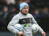 Coventry City coach Lee Carsley looks on as the players warm up prior to the npower League One match between Milton Keynes Dons and Coventry City at Stadium mk on December 29, 2012 in Milton Keynes, England.