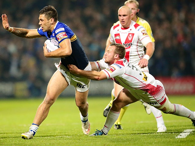 Adam Quinlan of St. Helens R.F.C pulls on Joel Moon of Leeds Rhinos during the First Utility Super League Semi Final between Leeds Rhinos and St Helens at Headingley Carnegie Stadium on October 2, 2015 in Leeds, England.