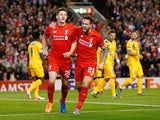 Adam Lallana of Liverpool (L) celebrates scoring the opening goal wth Danny Ings of Liverpool during the UEFA Europa League group B match between Liverpool FC and FC Sion at Anfield on October 1, 2015